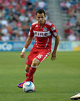 Chicago midfielder Marco Pappa (16) makes a move with the ball.  The Portland Timbers defeated the Chicago Fire 1-0 at Toyota Park in Bridgeview, IL on July 16, 2011.