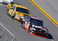 Apr 26, 2009; Talladega, AL, USA; NASCAR Sprint Cup Series driver Denny Hamlin (11) leads Matt Kenseth (17) during the Aarons 499 at Talladega Superspeedway. Mandatory Credit: Mark J. Rebilas-