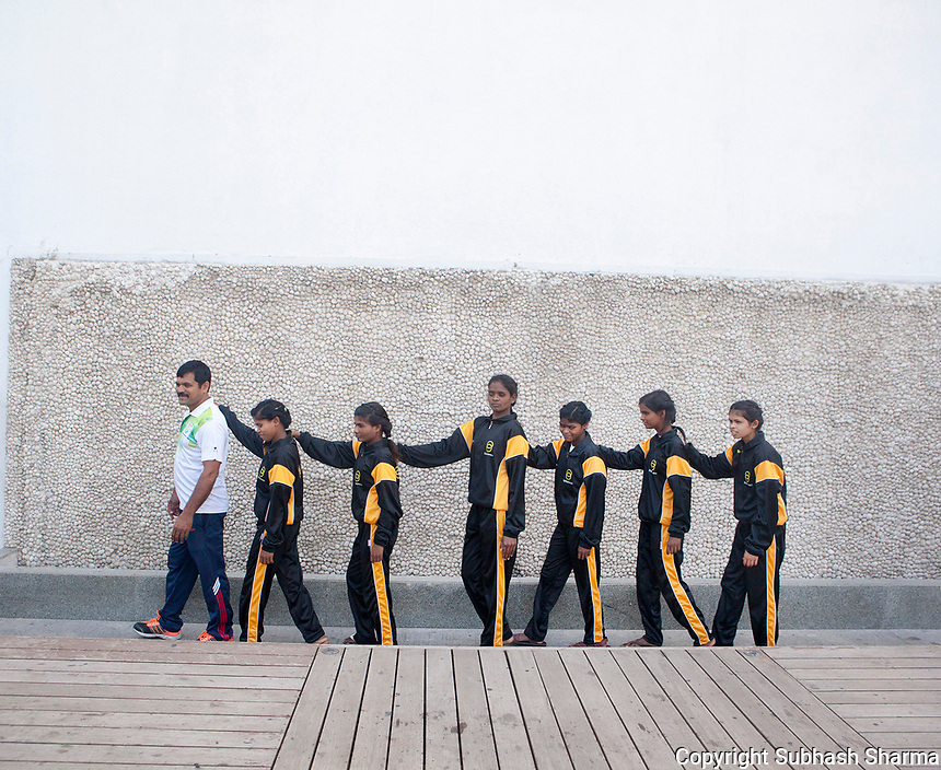 27 Feb 2017 - New Delhi - INDIA.<br /> <br /> Self Defence Coach, Mushtaq Khan,  trains visually impaired girls in Self Defence &amp; Judo techniques.<br /> <br /> Women and girls with disabilities are at a much higher risk of violence and abuse than their peers. Recently in the news there have been cases of young visually impaired girls being raped and sexually abused in India. <br /> As part of empowering and developing the skills of young visually impaired girls, Sightsavers is piloting an adolescent health programme to enable them to respond to real life situations in positive and responsive ways. As part of this Sightsavers is training visually impaired girls in self-defence. Many of the girls, who come from economically underprivileged backgrounds, have gone on to win medals in the National Blind and Deaf Judo Championships and a few want to go on to teach other girls with disabilities in the arts of self-defence. <br /> <br /> (Subhash Sharma for Sightsavers) Sightsavers - Visually Impaired Girls Learn Self Defense Skills.