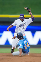 Winston-Salem Dash shortstop Cleuluis Rondon (13) fields a throw as Charcer Burks (24) of the Myrtle Beach Pelicans slides into second base at BB&T Ballpark on July 7, 2016 in Winston-Salem, North Carolina.  The Dash defeated the Pelicans 13-9.  (Brian Westerholt/Four Seam Images)