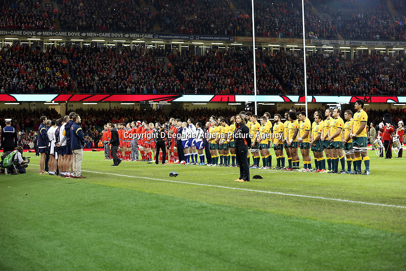 Pictured: Wales and Australia players observe a minute's silence for Remembrance Sunday. Saturday 08 November 2014<br /> Re: Dove Men Series rugby, Wales v Australia at the Millennium Stadium, Cardiff, south Wales, UK.