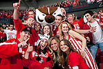 The Wisconsin Badgers mascot Bucky Badger poses with fans during an NCAA hockey game against the Alabama Huntsville Chargers at the Kohl Center in Madison, Wisconsin on October 15, 2010. The Badgers won 7-0. (Photo by David Stluka)