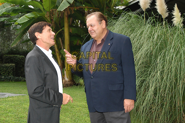 "GIANNI MORANDI & PAUL SORVINO.photocall for television transmission ""non facciamoci prendere dal panico"", sede rai, rome, Italy..Ref: CAV.September 25th, 2006.half length grey gray suit jacket blue finger pointing.www.capitalpictures.com.sales@capitalpictures.com.©Luca Cavallari/Capital Pictures."