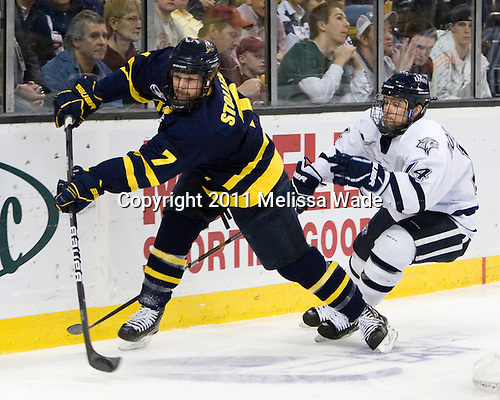 Karl Stollery (Merrimack - 7), Mike Borisenok (UNH - 14) - The Merrimack College Warriors defeated the University of New Hampshire Wildcats 4-1 (EN) in their Hockey East Semi-Final on Friday, March 18, 2011, at TD Garden in Boston, Massachusetts.