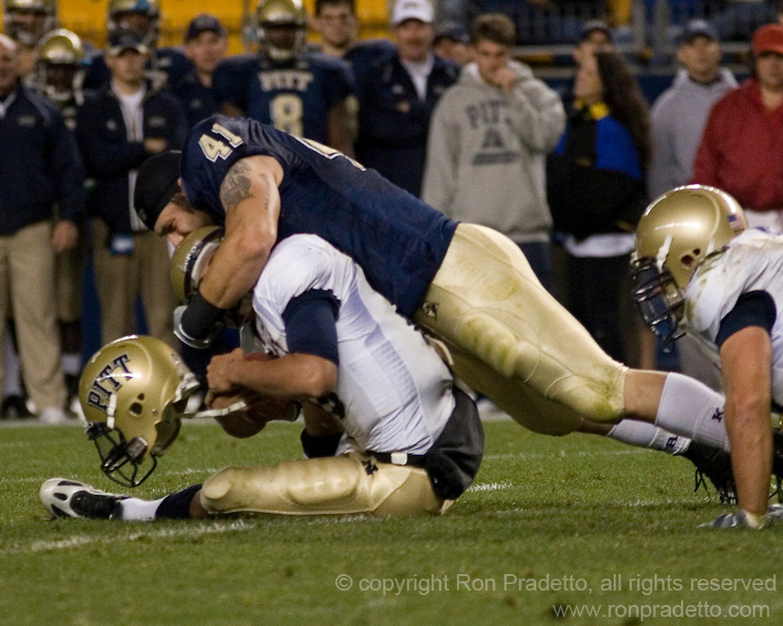 Pitt defensive lineman Chris McKillop loses his helmet while tackling a Navy ball carrier.  The Navy Midshipmen beat the Pitt Panthers 48-45 in double overtime on October 10, 2007 at Heinz Field, Pittsburgh, Pennsylvania.
