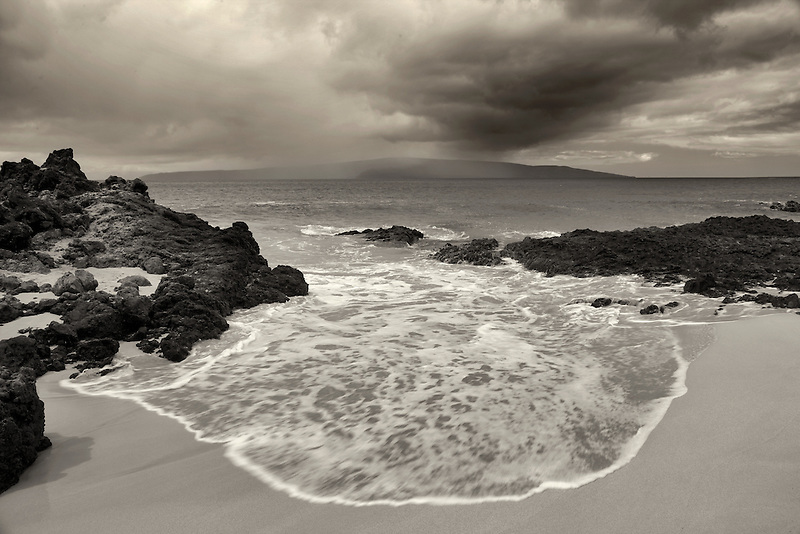 Storm with rain and beach off Maui, Hawaii.