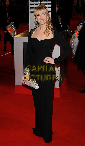 GUEST .Arrivals at the Orange British Academy Film Awards 2010 at the Royal Opera House, Covent Garden, London, England, UK, .21st February 2010.BAFTA BAFTAs full length long maxi black dress hand on hip Silver clutch bag.CAP/CAN.©Can Nguyen/Capital Pictures