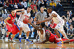 NASHVILLE, TN - MARCH 17:  Scottie Wilbekin #5 and Will Yeguete #15 of the Florida Gators fight Marshall Henderson #22 of the Ole Miss Rebels for a loose ball during the SEC Baskebtall Tournament Championship Game at Bridgestone Arena on March 17, 2013 in Nashville, Tennessee.  (Photo by Frederick Breedon/Getty Images)