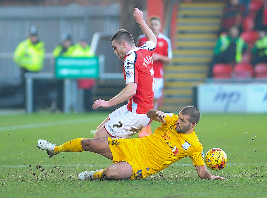 Preston North End's John Welsh is tackled by Crewe Alexandra's Oliver Turton<br /> <br /> Photographer Craig Thomas/CameraSport<br /> <br /> Football - The Football League Sky Bet League One - Crewe Alexandra v Preston North End - Sunday 28th December 2014 - Alexandra Stadium - Crewe<br /> <br /> &copy; CameraSport - 43 Linden Ave. Countesthorpe. Leicester. England. LE8 5PG - Tel: +44 (0) 116 277 4147 - admin@camerasport.com - www.camerasport.com