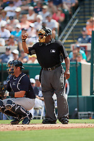 Home plate umpire Laz Diaz calls a strike during a Grapefruit League Spring Training game between the New York Yankees and the Detroit Tigers on February 27, 2019 at Publix Field at Joker Marchant Stadium in Lakeland, Florida.  Yankees defeated the Tigers 10-4 as the game was called after the sixth inning due to rain.  (Mike Janes/Four Seam Images)