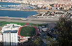 View over airport runway to Spanish town of La Linea from Gibraltar, British overseas territory in southern Europe