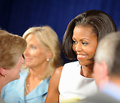 United States First Lady Michelle Obama and Dr. Jill Biden greet guests after attending an event about the Affordable Care Act at George Washington University Hospital, on Wednesday, July 14, 2010, in Washington, DC.  .Credit: Leslie E. Kossoff - Pool via CNP