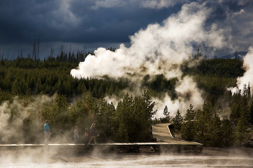 Hikers explore a thermal area in Yellowstone National Park.