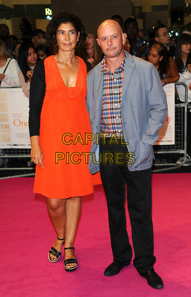 "Amanda Posey & Nick Hornby.""One Day"" UK premiere, Vue Westfield cinema, Westfield Shopping Centre, London, England..August 23rd, 2011.full length orange red dress married husband wife plaid check blue pink grey gray goatee facial hair black cardigan trousers hand in pocket .CAP/CJ.©Chris Joseph/Capital Pictures."