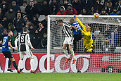 9th December 2017, Allianz Stadium, Turin, Italy; Serie A football, Juventus versus Inter Milan; Goalkeeper Samir Handanovic clears the ball put as Mario Mandzukic and Miranda miss the cross
