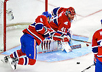 9 January 2010: Montreal Canadiens' goaltender Jaroslav Halak makes a second period save against the New Jersey Devils at the Bell Centre in Montreal, Quebec, Canada. The Devils edged out the Canadiens 2-1 in overtime. Mandatory Credit: Ed Wolfstein Photo