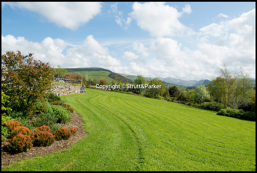 BNPS.co.uk (01202 558833)<br /> Pic: Strutt&amp;Parker/BNPS<br /> <br /> ***Please use full byline***<br /> <br /> The gardens.<br /> <br /> A stunning country pad that looks like it could have been designed by Hobbit hero Bilbo Baggins has gone on the market for one million pounds.<br /> <br /> The wonderfully wacky house appears to blend in with its surroundings, just like the Lord of the Rings character's humble Hobbit hole.<br /> <br /> The plush five-bedroom property is nestled deep in the rolling hills of Wales' Snowdonia National Park - although it would not look out of place in Middle Earth.<br /> <br /> The house is called Cynefin, meaning 'a sense of place' in Welsh, and is in the tiny village of Llanegryn in Gwynedd wih unrivalled views over the Dysynni Valley.<br /> <br /> It is on the market through estate agents Strutt and Parker for &pound;985,000.