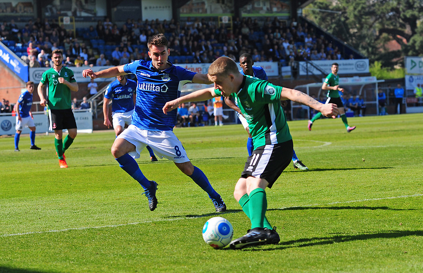 Lincoln City's Terry Hawkridge crosses under pressure from Eastleigh's Ben Close<br /> <br /> Photographer Andrew Vaughan/CameraSport<br /> <br /> Vanarama National League - Eastleigh v Lincoln City - Saturday 8th April 2017 - Silverlake Stadium - Eastleigh<br /> <br /> World Copyright &copy; 2017 CameraSport. All rights reserved. 43 Linden Ave. Countesthorpe. Leicester. England. LE8 5PG - Tel: +44 (0) 116 277 4147 - admin@camerasport.com - www.camerasport.com