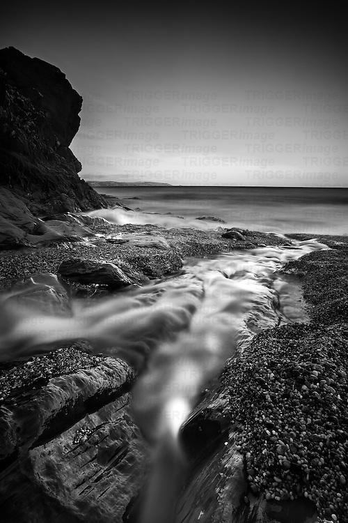 British coastal scene with long exposure on rocky beach