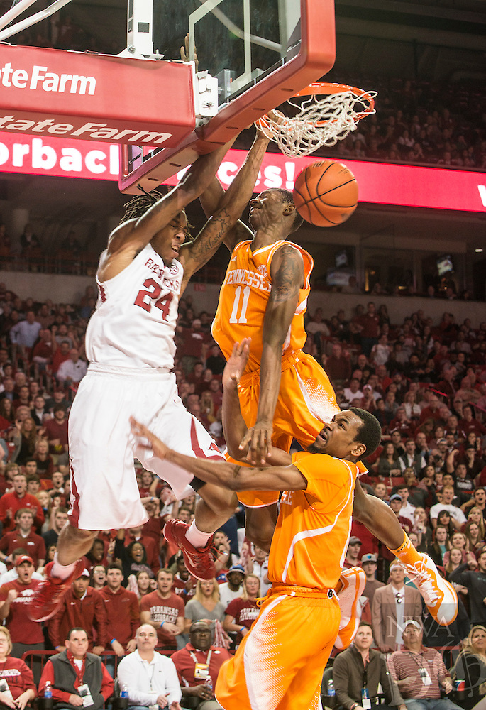 NWA Democrat-Gazette/ANTHONY REYES • @NWATONYR<br /> Michael Qualls, Arkansas junior, dunks against Tariq Owens, Tennessee freshman in the second half Tuesday, Jan. 17, 2015 in Bud Walton Arena in Fayetteville. The Razorbacks won 69-64.