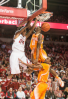NWA Democrat-Gazette/ANTHONY REYES &bull; @NWATONYR<br /> Michael Qualls, Arkansas junior, dunks against Tariq Owens, Tennessee freshman in the second half Tuesday, Jan. 17, 2015 in Bud Walton Arena in Fayetteville. The Razorbacks won 69-64.