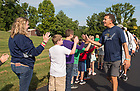 August 14, 2017; Lou Nanni, vice president of University Relations, is greeted by students from North Knox School during the 19 mile trek of Day 1 on the ND Trail from Vincennes to Oaktown, Indiana. As part of the University's 175th anniversary celebration, the Notre Dame Trail will commemorate Father Sorin and the Holy Cross Brothers' journey. A small group of pilgrims will make the entire 300+ mile journey from Vincennes to Notre Dame over  two weeks. (Photo by Barbara Johnston/University of Notre Dame)