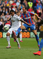 Pictured L-R: Kyle Naughton of Swansea is challenged by Glenn Murray of Crystal Palace<br />