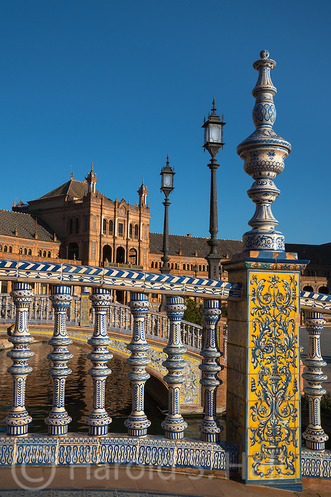 Plaza de España was built in 1928 for the Seville, Spain World's Fair in 1929.  While this palace area is vast, the surrounding area improved just for the World's Fair is much larger.  Acres of gardens were created and surrounding streets with elegant homes were built for the wealthy.  These residences were to prevent ugly commercial buildings from eventually crowding in on the area.  This plaza is full of benches, canals, Spanish tiled alcoves and bridges.  It has been the setting for movies from Laurence of Arabia to Star Wars.