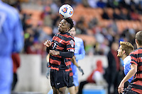Houston, TX -  Friday, December 9, 2016: Bryce Marion (7) of the Stanford Cardinal heads the ball towards the North Carolina Tar Heels goal in the first half of the  NCAA Men's Soccer Semifinals at BBVA Compass Stadium.