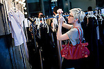 JOHANNESBURG, SOUTH AFRICA - MARCH 27: A buyer takes photos of clothes after a fashion show at the South African fashion week on March 27, 2010, Turbine Hall in central Johannesburg, South Africa. Buyers and celebrities watched the 3 day fashion week, a biannual event. (Photo by Per-Anders Pettersson)