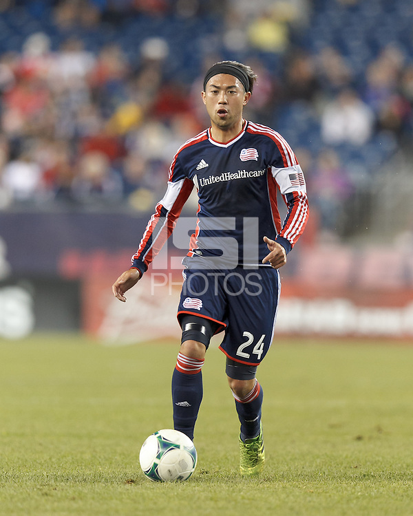 New England Revolution midfielder Lee Nguyen (24) brings the ball forward.  In a Major League Soccer (MLS) match, Montreal Impact (white/blue) defeated the New England Revolution (dark blue), 4-2, at Gillette Stadium on September 8, 2013.