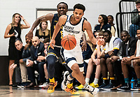 WASHINGTON, DC - FEBRUARY 22: Jameer Nelson Jr. #12 of George Washington moves away from David Betty #1 of La Salle during a game between La Salle and George Washington at Charles E Smith Center on February 22, 2020 in Washington, DC.