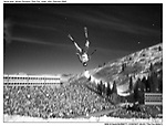"With sun bouncing off the clouds in Park City, Utah, an Aerial Skier takes flight off the jump in front of 14000 spectators at the 2002 Olympic Winter Games...©2002 David Burnett/Contact -SLOC ""The Fire Within""."
