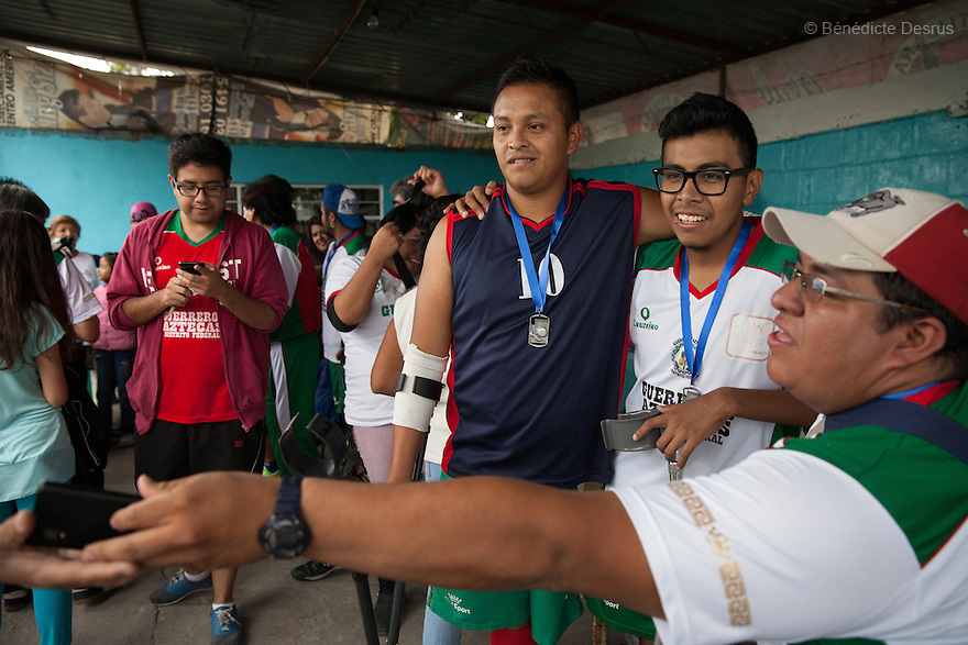 """Baruch with his teammates at Guerreros Aztecas's first anniversary celebrations in Mexico City, Mexico on July 5, 2014. Baruch Alejandro Anleu Ramirez, 18, is the captain of Guerreros Aztecas. Two years ago, Baruch had his left leg amputated due to bone cancer. He used to practice as much as his chemotherapy would allow. Expelled from school for missing too many classes during his treatment, he says, """"Guerreros Aztecas has filled a big hole in my life"""". Baruch was Guerreros Aztecas's brightest hope to represent Mexico at the Amputee Soccer World Cup. But since the cancer's spread to his lungs, he can no longer play or train with the team. Guerreros Aztecas (""""Aztec Warriors"""") is Mexico City's first amputee football team. Founded in July 2013 by five volunteers, they now have 23 players, seven of them have made the national team's shortlist to represent Mexico at this year's Amputee Soccer World Cup in Sinaloathis December.The team trains twice a week for weekend games with other teams. No prostheses are used, so field players missing a lower extremity can only play using crutches. Those missing an upper extremity play as goalkeepers. The teams play six per side with unlimited substitutions. Each half lasts 25 minutes. The causes of the amputations range from accidents to medical interventions – none of which have stopped the Guerreros Aztecas from continuing to play. The players' age, backgrounds and professions cover the full sweep of Mexican society, and they are united by the will to keep their heads held high in a country where discrimination against the disabled remains widespread.(Photo byBénédicte Desrus)"""