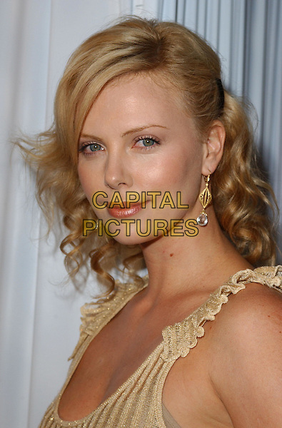 CHARLIZE THERON.Attends the 2004 Best Friends Lint Roller Party held at The Hollywood Athletic Club in Hollywood,California.April 28,2004.headshot, portrait, earrings.www.capitalpictures.com.sales@capitalpictures.com.Supplied By Capital PIctures