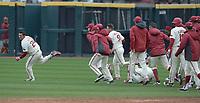 NWA Democrat-Gazette/J.T. WAMPLER Arkansas' Dominic Fletcher runs from his celebrating teammates after hitting an RBI to beat USC Sunday March 4, 2018. Arkansas won 7-6 in seven innings.