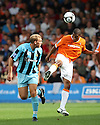 Shane Blackett of Luton heads clear watched by Danny Wright of Cambridge United during the Blue Square Bet Premier match between Luton Town and Cambridge United at Kenilworth Road, Luton  on 11th September 2010.© Kevin Coleman 2010