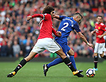 Marouane Fellaini of Manchester United tackles Morgan Schneiderlin of Everton during the premier league match at the Old Trafford Stadium, Manchester. Picture date 17th September 2017. Picture credit should read: Simon Bellis/Sportimage