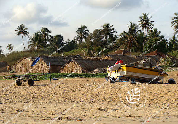 Huts and boat at the Goa beach.