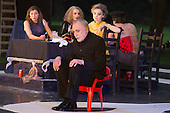 "11 July 2014, Muelheim/Ruhr, Germany. Volker Roos as Creon/Kreon in front of (from left) Petra von der Beek as Ismene, Rosmarie Bruecher as Euridyke and Simone Thoma as Antigone. Roberto Ciulli's ""Theater an der Ruhr"" perform ""Antigone"" as part of their open-air season ""Weisse Naechte"" (White Nights) in Raffelbergpark, Muelheim an der Ruhr, Germany."