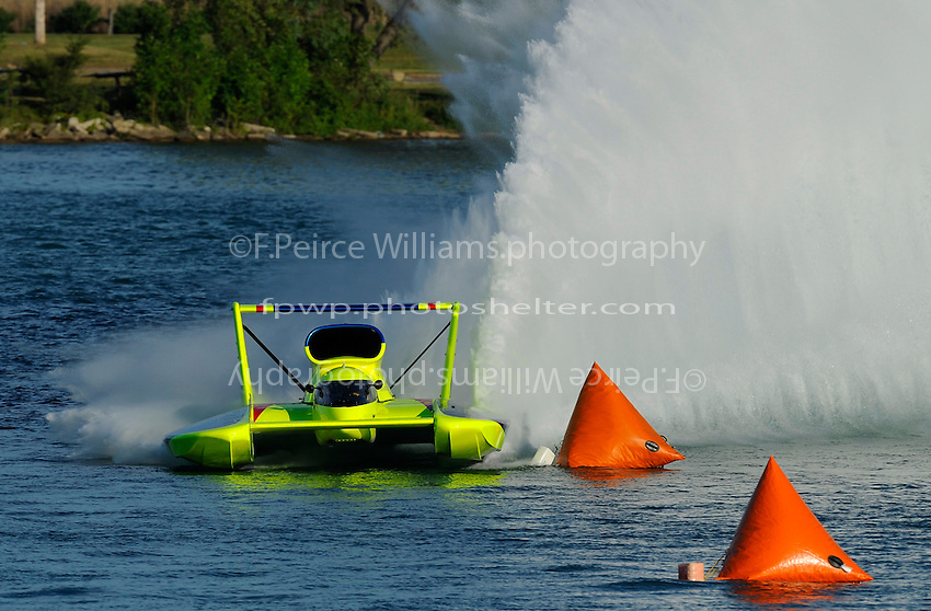 "Frame 3: J. W. Myers, U-37 ""Miss Peters & May"" cuts a tight, high speed turn through Detroit's famous Roostertail Turn."