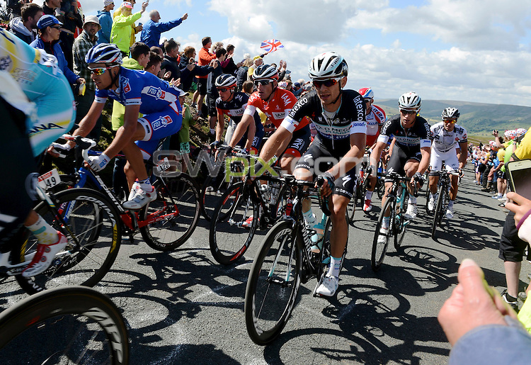 Picture by Dean Atkins/SWpix.com - 05/07/2014 - Cycling - Tour de France 2014 Grand Depart - Stage 1, Leeds to Harrogate - Yorkshire, England - <br /> The Peloton climbs the Cote De Grinton Moor