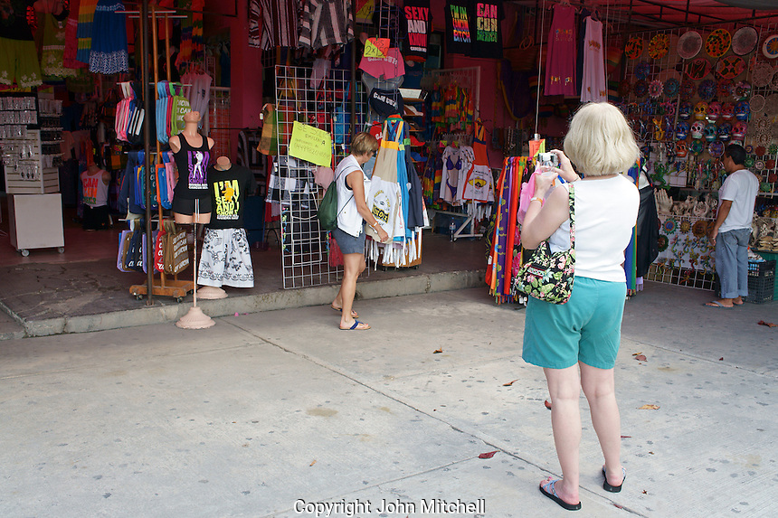 Middle aged women tourists in Mercado 28 souvenirs and handicrafts market in  Cancun, Mexico      .