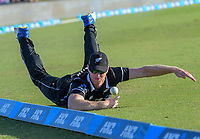 Jimmy Neesham tries to stop the ball on the boundary during One Day International cricket match between NZ Black Caps and Sri Lanka at Mount Maunganui, New Zealand on Saturday, 5 January 2019. Photo: Dave Lintott / lintottphoto.co.nz