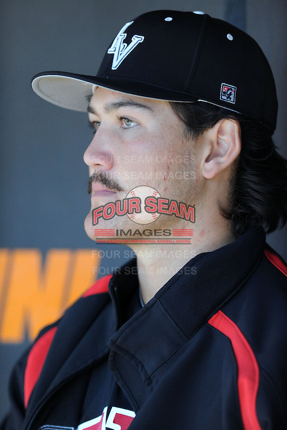 UNLV Runnin' Rebels starting pitcher John Richy #45 on the bench between innings during a game against the Tennessee Volunteers at Lindsey Nelson Stadium on February 22, 2014 in Knoxville, Tennessee. The Volunteers defeated the Rebels 5-4. (Tony Farlow/Four Seam Images)