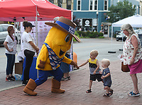 NWA Democrat-Gazette/CHARLIE KAIJO Hostess mascot Twinkie The Kid greets Hudson Moyer, 3, Parker Moyer, 1, of Rogers and their grandmother Tammy Linder, Monday, June 3, 2019 at the downtown square in Bentonville<br />