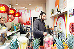 Istanbul - Turkey - 04 February 2015 -- Young entrepreneurs. -- Bilal Kandemir, 32, a fruit juice seller, makes a juice for a customer  -- PHOTO: Agata SKOWRONEK / EUP-IMAGES