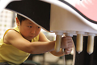 Thomas Kwon, 5, of Bellingham, milks a toy cow at the NW Washington Fair. August 20, 2009 PHOTOS BY MERYL SCHENKER ..