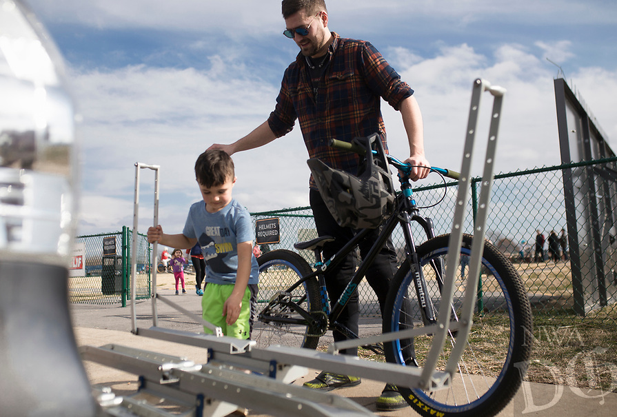 """Gus Springer, 4, (from left) and his dad Zach Springer, 34, of Bentonville pack their bikes after practicing riding for the Red Bull Pump Track World Championship qualifier, Sunday, January 26, 2020 at the Runway Bike Park in Springdale. Check out nwaonline.com/200127Daily/ for today's photo gallery.<br /> (NWA Democrat-Gazette/Charlie Kaijo)<br /> <br /> The Redbull Pump Track World Championship qualifier is on April 25th at the Runway Bike Park. """"We found Red Bull was hosting the championship and they're coming back. This is the only place in the US that hosts that,"""" said Andrew Schacherbauer who's practicing to qualify. """"There was someone who podiumed to qualify for this year's championship. It's inspiring to know someone local get in."""""""