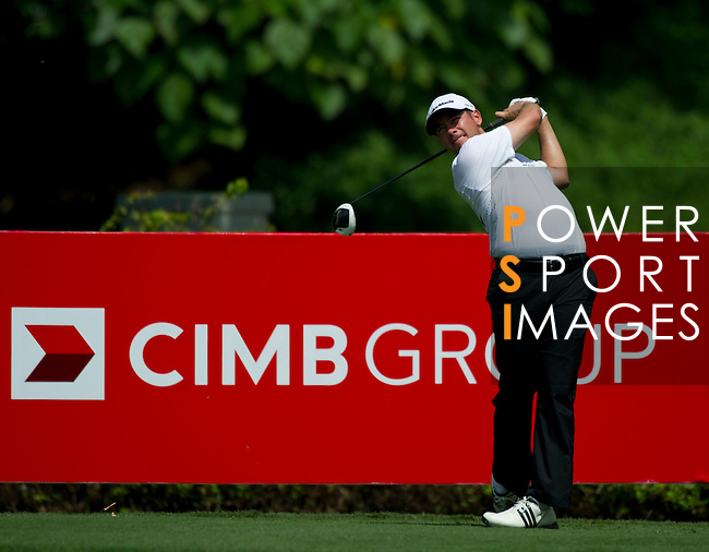 Chez Reavie tees off at the eighth during Round 2 of the CIMB Asia Pacific Classic 2011.  Photo © Raf Sanchez / PSI for Carbon Worldwide